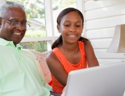 Grandpa with granddaughter at computer