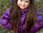 Little girl wearing purple jacket