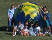 kids sitting by globe