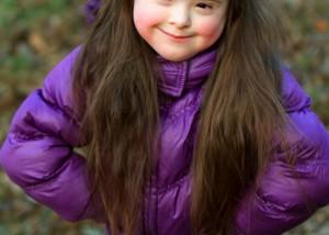 Little girl wearing purple jacket