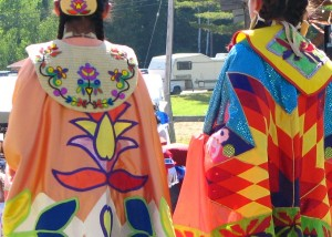 Two American Indian girls wearing colorful shawls